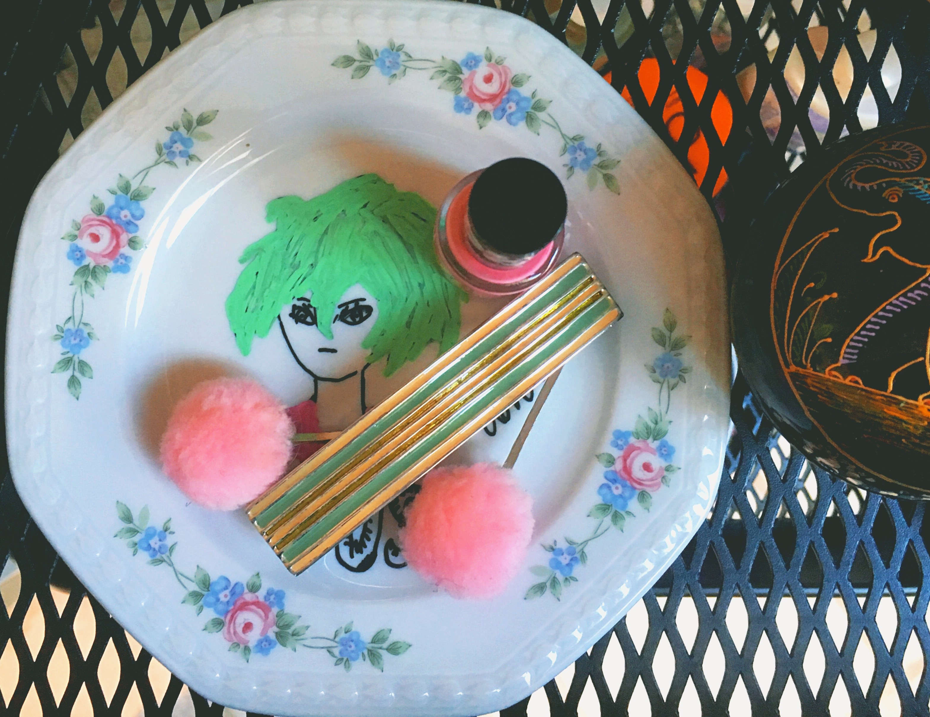 A plate with som hair accessories and nail polish